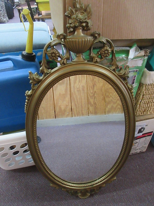 """Oval mirror, plastic gold ornate frame with bow design on top 17x30"""""""