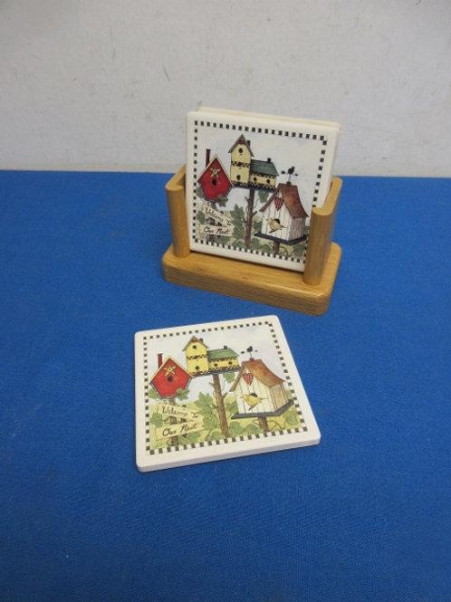 Set of 4 birdhouse coasters in wood rack