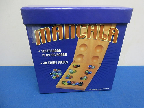 Mancala game - solid wood playing board with 48 stone pieces