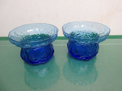 Pair of round blue glass candle holders with raised rim