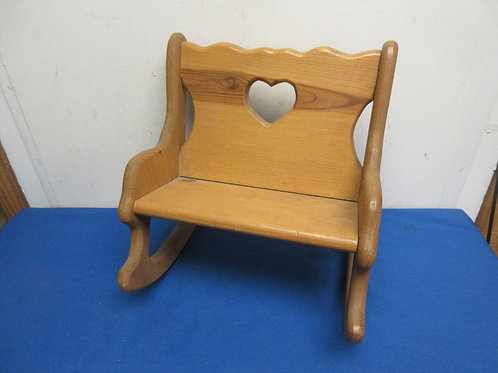 Wooden rocking chair for a baby doll