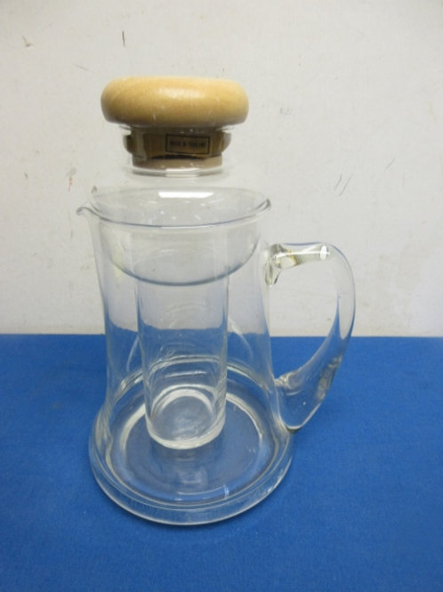 Glass wide base pitcher with glass insert to hold ice cubes