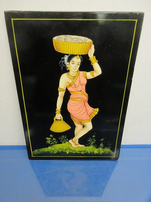 Picture of female with basket on her head on a black plaque, from India, 12x17