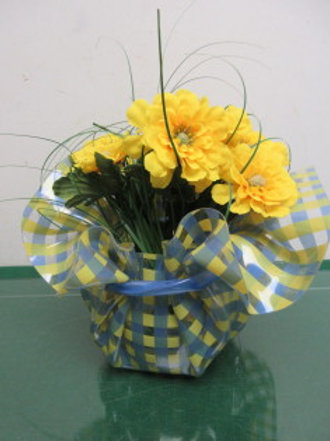 Clear blue & yellow plastic bowl yellow floral arrangement