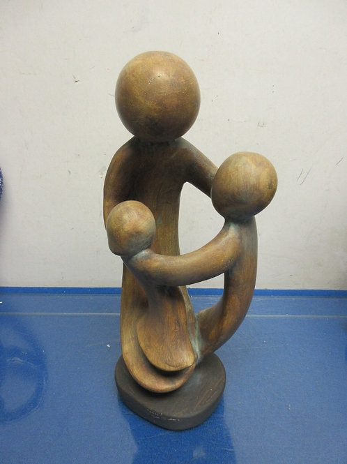 """Metal family sculpture of 3 people playing ring around  the rosie, 11"""""""