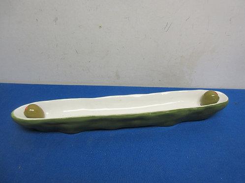 Green and white long narrow ceramic olive dish