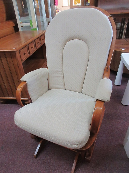 Glider rocker, ivory seat and back cushions