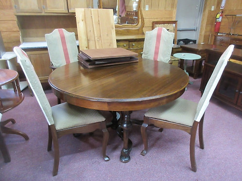 Antique round table w/4 leaves, table pads, and 4 pennsylvania house chairs