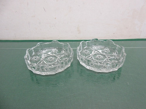 Two small round glass ashtrays