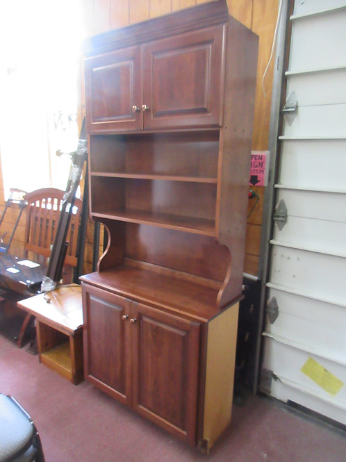 Cherry tone 2 pc cabinet with tall hutch, has one unfinished side