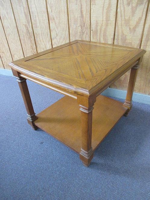 "Medium tone end table with bottom shelf 22x26x21""high, 2 available"