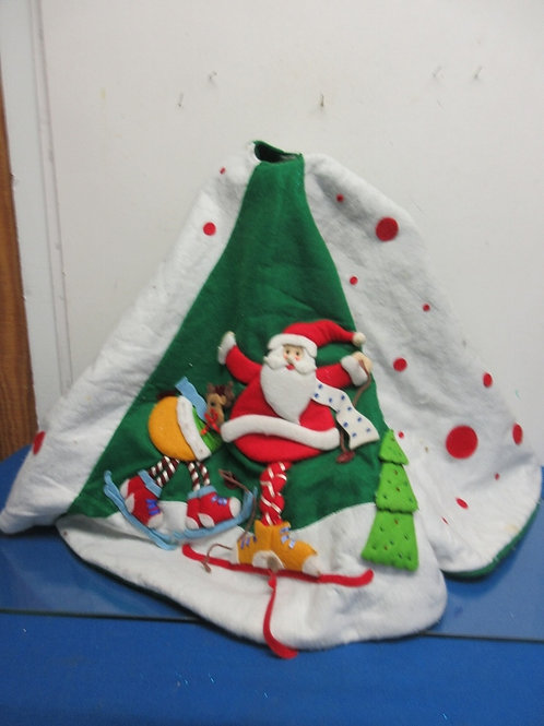 Large green fabric tree skirt with dimensional santa scene
