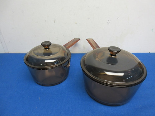 Pair of brown glass vision saucepans with lids - 1 liter and 1.5 liters