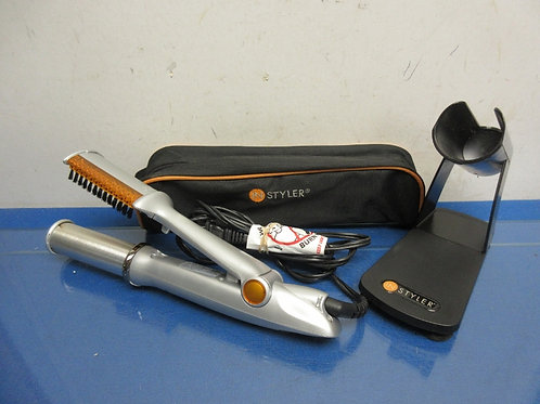 Instyle curling iron/brush combo with holder
