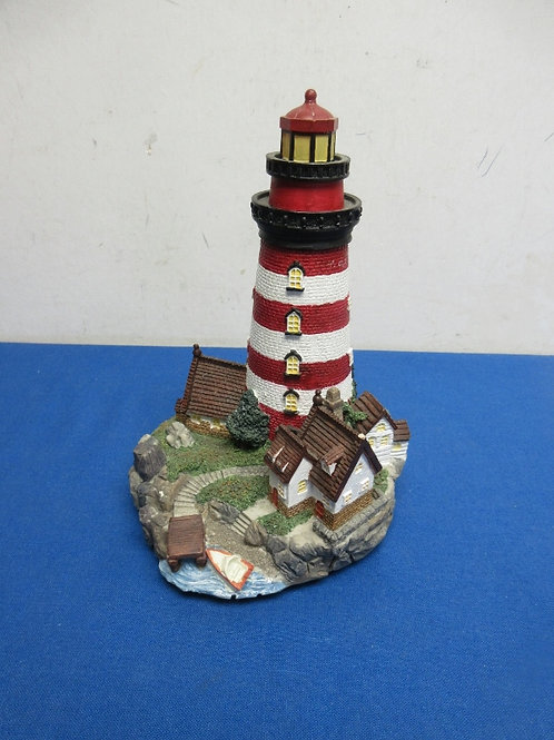 Musical lighthouse that lights up - plays You light up my life