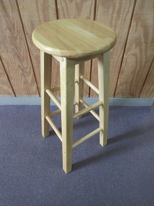 Natural tone stool with round seat