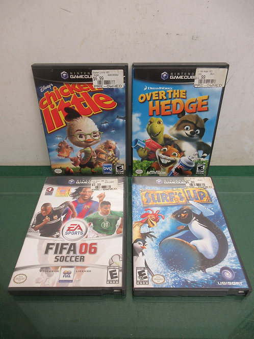 Set of 4 Nintendo game cube games, surfs u, fifa 06, over the hedge, chicken lit