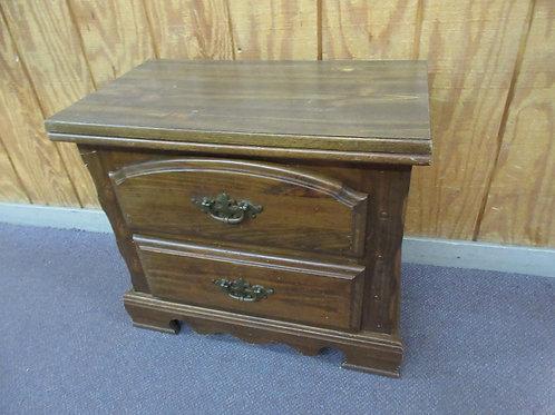 Dark 2 drawer nightstand with wood grain formica top