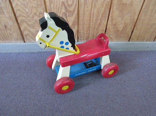 Vintage Fisher Price small riding horse on wheels