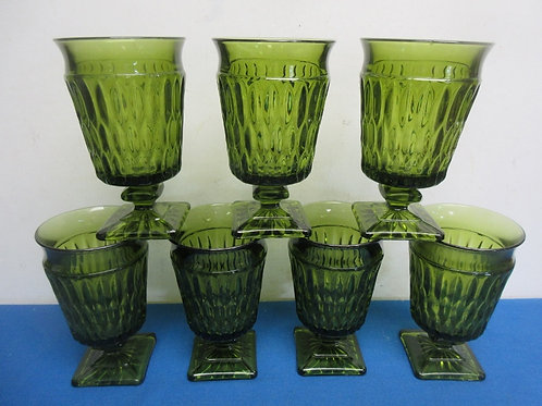 Set of 7 green glass footed tumblers