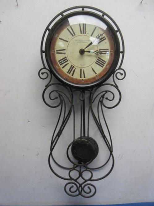 Pendulum wall clock with roman numerals