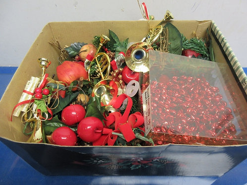 Small box of various ornaments for tree and red bead garland
