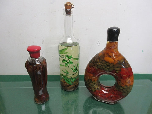 Set of 3 decorative bottles filled with spices & beans, one is donut shaped