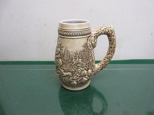 Stein mug with dimensional scene around sides