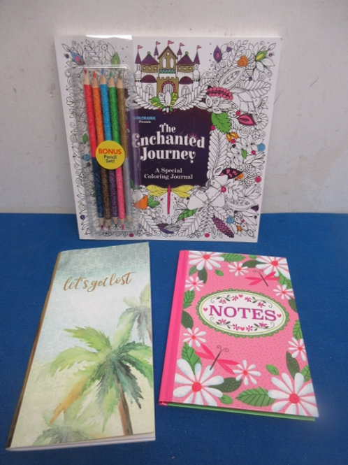 Adult coloring book with colored pencils, a journal, and black callender book -