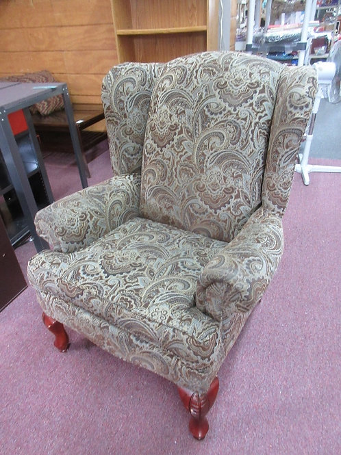 Blue and tan paisley design wing back chair