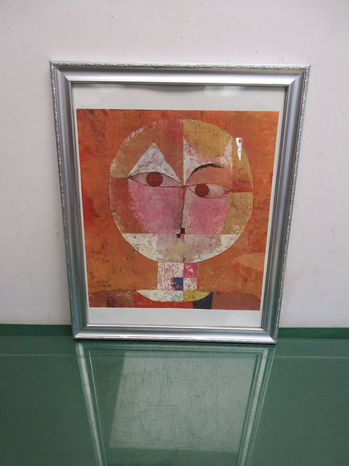 Abstract print of a face, white mat, silver frame 12x16