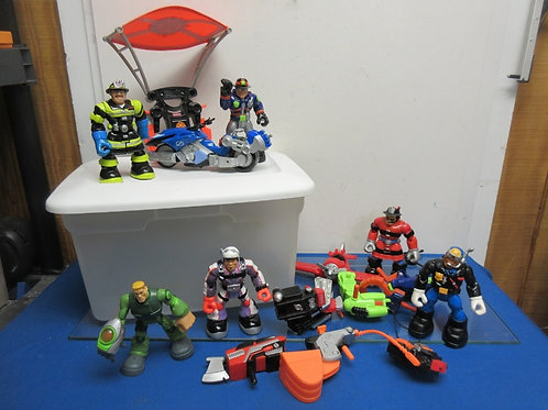 Clear bin filled with Fisher Price rescue hero action figures & accessories