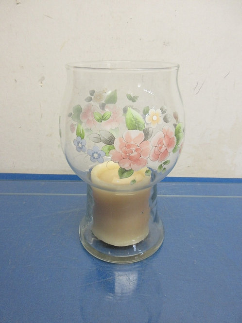 Clear glass pillar candle holder with floral design includes candle
