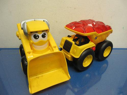 Pair of yellow construction vehicles, dump truck and bull dozer