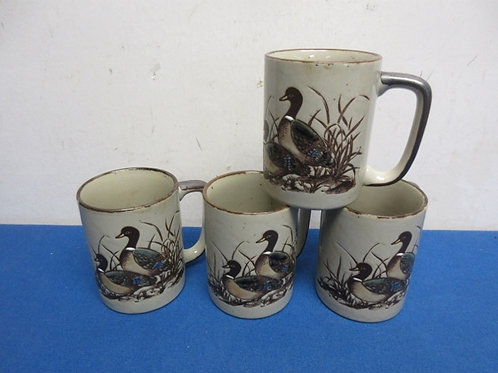 Set of 4 mugs with mallard style duck designs