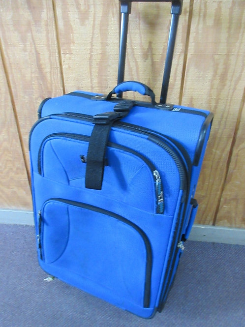 Large blue delsey suitcase on wheels - some wear