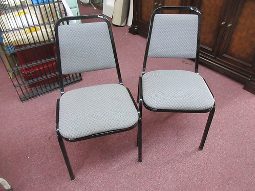 Pair of black frame gray dinette chairs