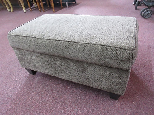 Light brown upholstered rectangular ottoman with storage & hinged lid