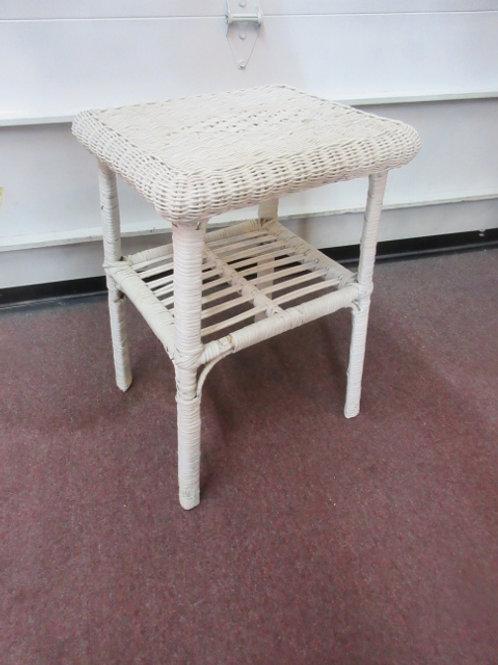 "White wicker side table with bottom shelf, 14x16x22"" high"