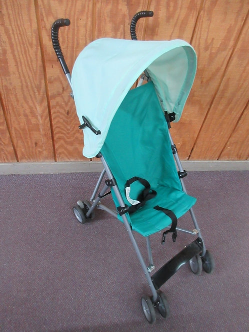 Green umbrella stroller with roof