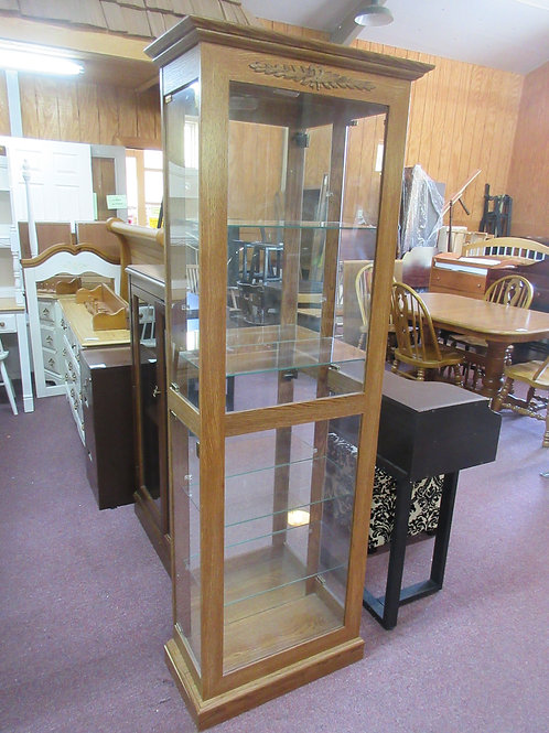 Lighted oak curio cabinet with mirror back and adjustable glass shelves