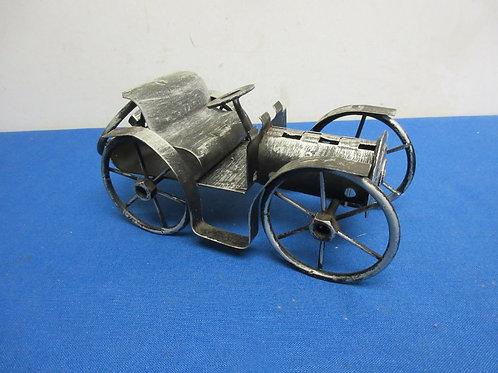 Handmade metal welded model of an antique car