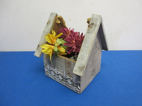 Birdhouse shaped wood planter with artificial flowers