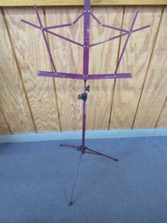 One piece folding cranberry color metal music stand