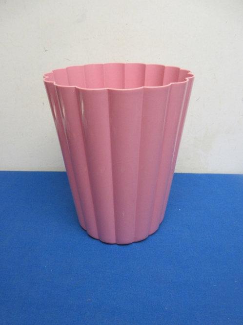 small pink plastice waste basket