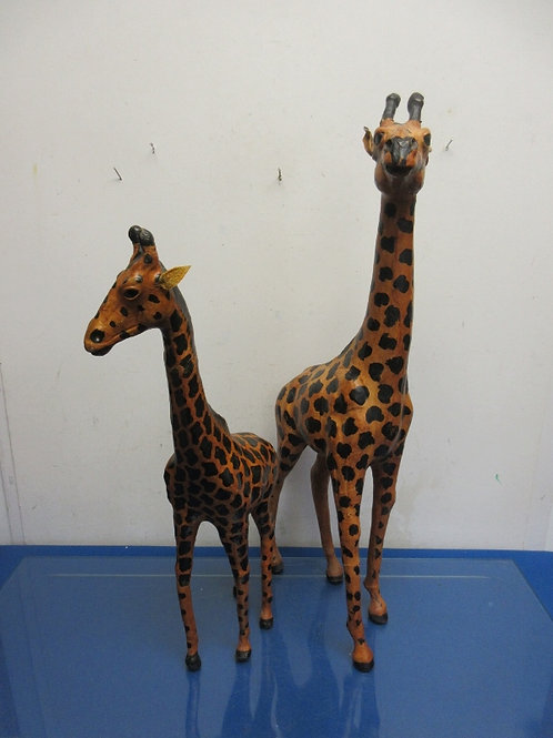 "Pair of leather covered giraffe statues 24"" and 19"""