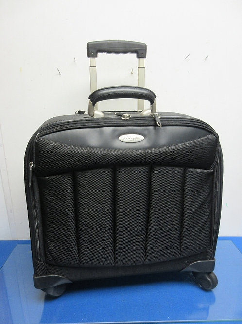 Samsonite black carry on suitcase on wheels with pull up handle