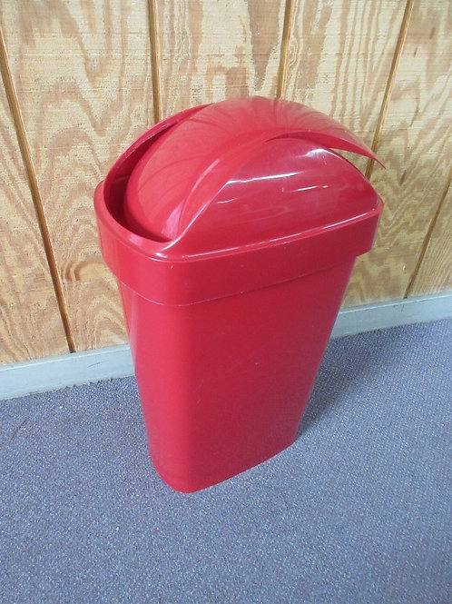 Red medium size trash can with a flip top lid