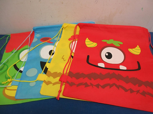 Set of 4 pull string bags w/cartoon monsters on the side