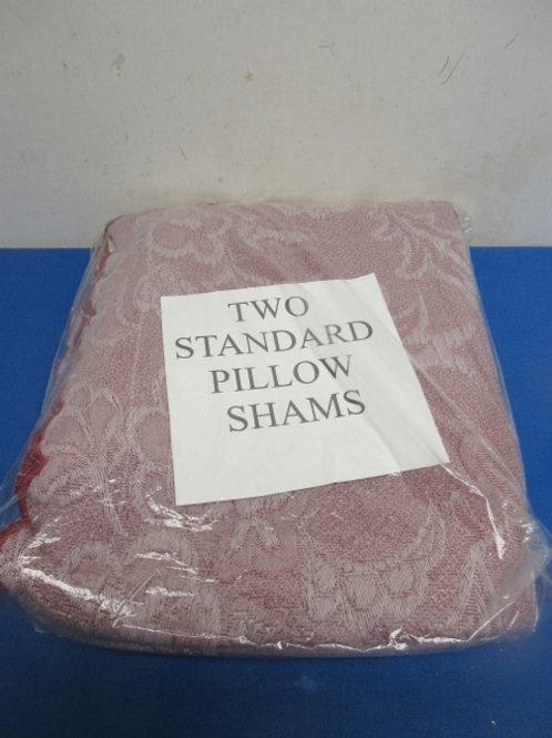 Pair of burgundy embossed standard pillow shams